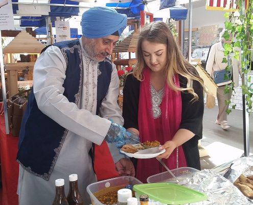 Andy and Abby selling samosas in their asian finery