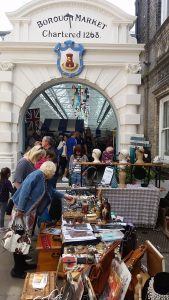 the market entrance showing vintage stalls and busy with shoppers