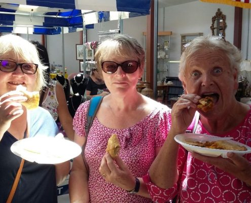 Three lovely ladies enjoying Andy Singhs samosas