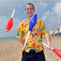 tom from the circus juggling batons